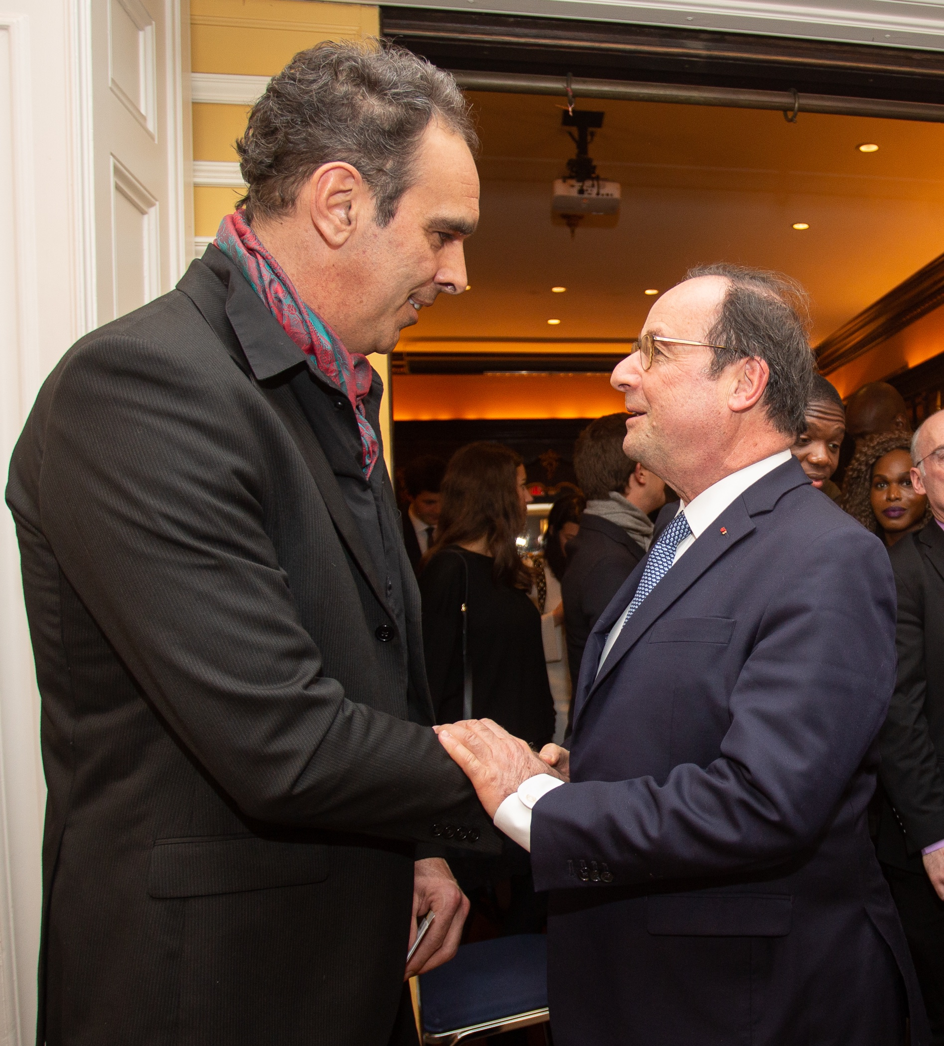 Former President of the French Republic François Hollande with FACCNE board member Alban Maino at the French Cultural Center on March 10, 2019
