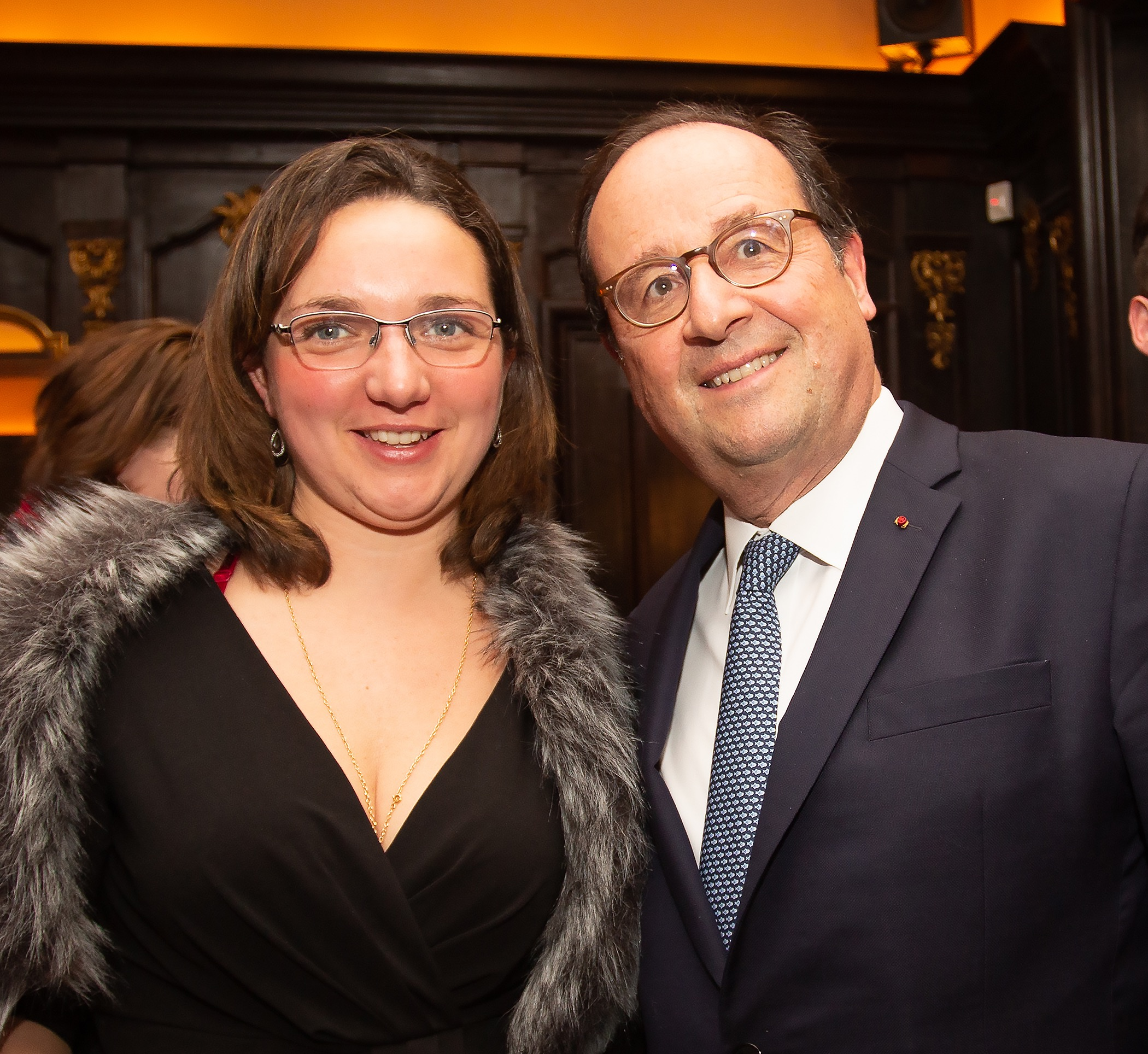 Former President of the French Republic François Hollande with FACCNE volunteer Claire Dorin at the French Cultural Center on March 10, 2019