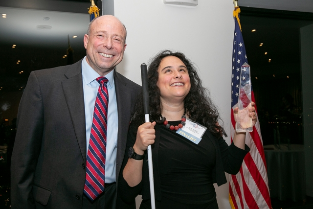 Lindsay Yazzolino, assistive technology expert and representative for InsideVision, the recipient of the 2019 Business Jury's Choice Award (sponsored by Saul Ewing Arnstein & Lehr), poses for a picture with Steve Eichel, Partner at Saul Ewing Arnstein & Lehr, at FACCNE's 18th Annual French-American Business Awards