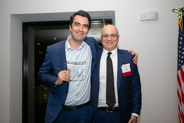 Alexis Normand, head of Consortium for Embleema, the runner-up for the FAB Awards Small Company of the Year, poses for a picture with Sergio Corbo, Chief Marketing Officer at Veolia, at FACCNE's 18th Annual French-American Business Awards