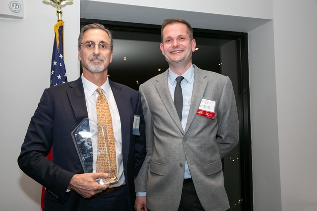 Larry Schwartz, Chairman & CEO of Seaborn Networks, the 2019 FAB Awards Medium Company of the Year, poses for a picture with Stephan Dubouloz, Deputy General Counsel at Natixis Investment Managers, at FACCNE's 18th Annual French-American Business Awards