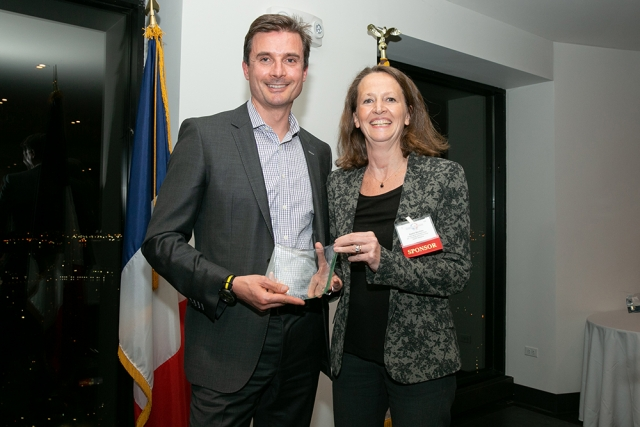 Laurent Audoly,  CEO of Kymera Therapeutics, the runner-up for the FAB Awards Medium Company of the Year, poses for a picture with Sophie Bocchino-Salette, Global Value & Access Head for MS, Oncology and Immunology at Sanofi Genzyme,  at FACCNE's 18th Annual French-American Business Awards